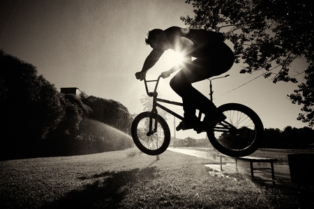 boy jumping on bmx inside splashes Stock Photo - 9846348