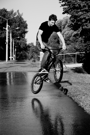 boy jumping  on bmx photo