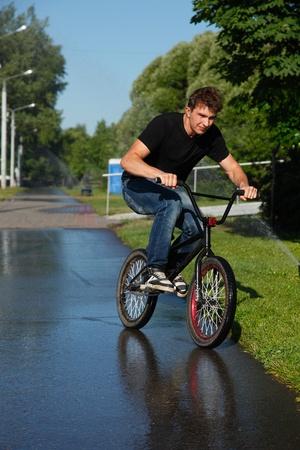 boy riding   on street  bmx photo