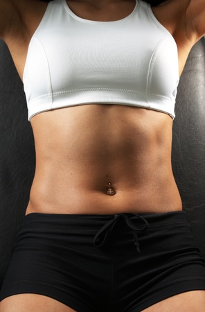Close-up muscular woman abdomen photo