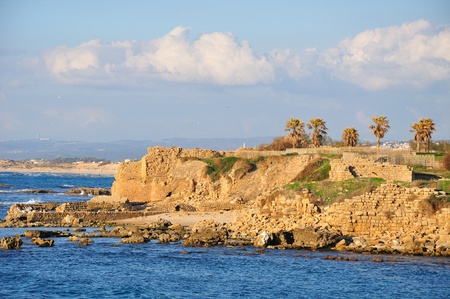 View of Caesarea seashore with half-ruined fortification wall.