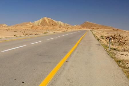 Perspective of highway in Negev desert. Israel.  photo