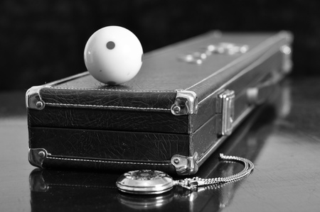 Cue ball on vintage cue case. Stock Photo