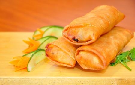 Portion of Chinese eggrolls Imagens