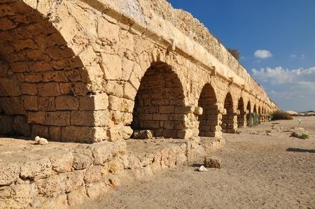 holyland: Roman aqueduct at Caesarea coast.