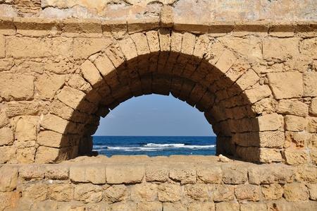 holyland: Arch of Roman aqueduct at Caesarea coast. Stock Photo