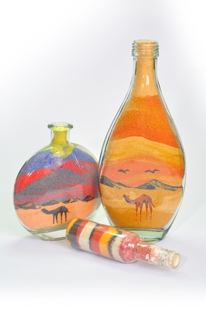 colored bottle: Souvenir bottles  filled with colorful sands from Timna park. South Israel. Stock Photo