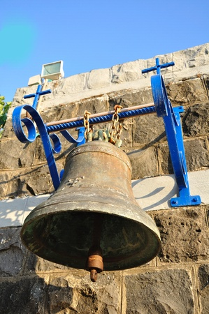 holyland: The bell in the church yard  Capernaum   Stock Photo