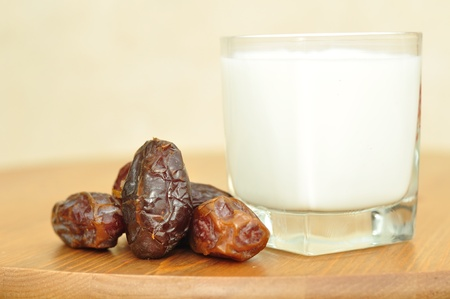 Dates and a glass of milk on a wooden table. Stock Photo - 11072487