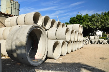 Pile of big pipes at construction site  Stock Photo