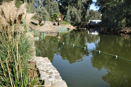 Baptismal site at Jordan river shore  Israel  photo