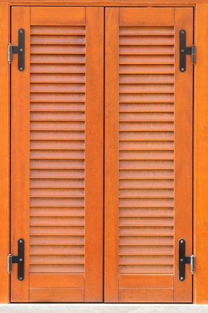 Window of a house closed with shutters  photo