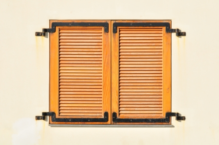 Window of a house in Tel Aviv closed with shutters photo