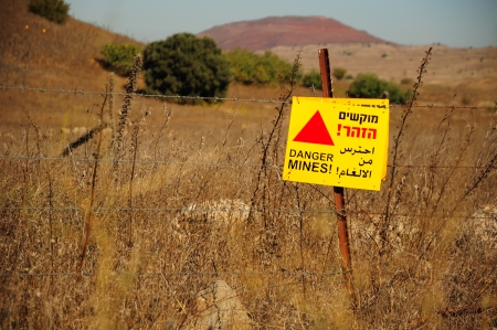 the golan heights: Signboard warning about minefield at Golan Heights  Israel