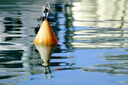 buoyancy: Buoy floating on water surface in old Jaffa port