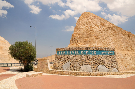 holyland: Stone wall that points the sea level at the way to the dead sea  Israel