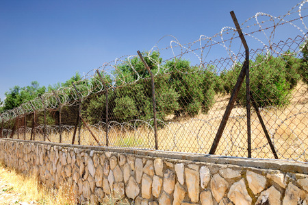 Garden in Jerusalem enclosed with the barbed wire fence    photo
