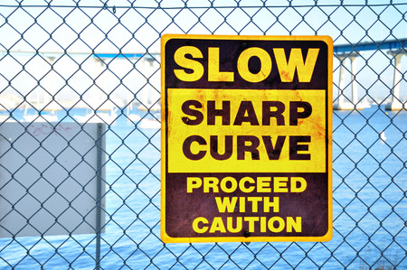 Warning signboard on the net fence. San Diego. USA.