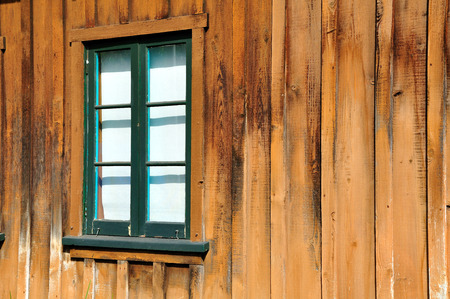 Window in the wall of wooden house. Stock Photo