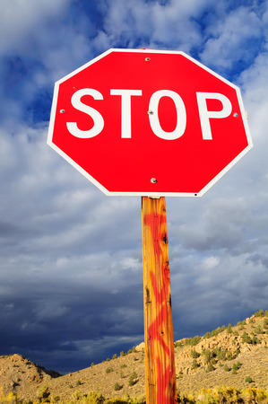 prohibitive: Prohibitory stop traffic sign under cloudy sky. Stock Photo