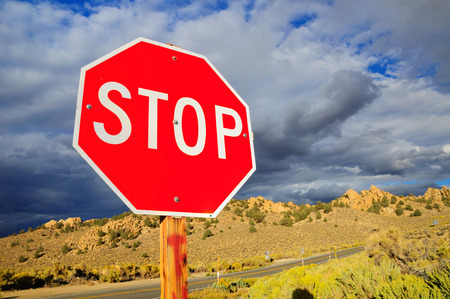 Prohibitory stop traffic sign under cloudy sky. Stock Photo