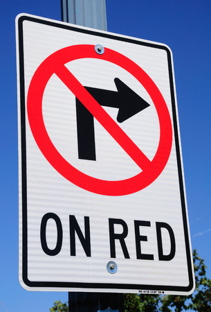 Traffic sign prohibiting right turn on red traffic light. photo