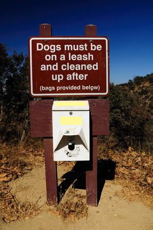 signboard: Signboard warning about dog walking rules. USA.
