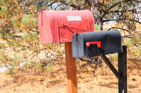 dropbox: Old styled mailbox in american countryside area.