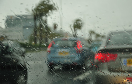 windscreen: Abstract view to rainy city through the car windscreen. Photographed in Israeli winter.