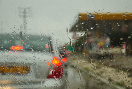 Abstract view to rainy city through the car windscreen. Photographed in Israeli winter.