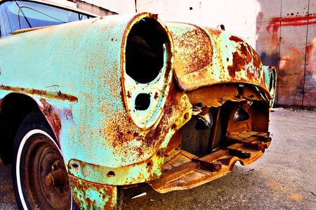 Old rusty retro car in the garage territory. Stock Photo