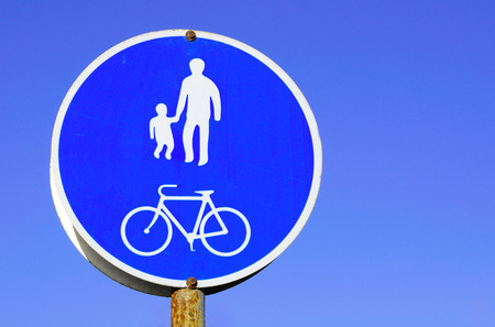 Informative traffic sign warning about bicycle and pedestrian path. Stock Photo