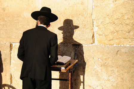 Religious orthodox jew praying at the Western wall in Jerusalem old city. Stock Photo