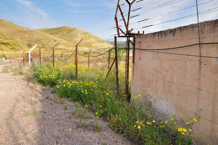 the golan heights: Boundary fence at the Israeli syrian border at the Golan Heights.