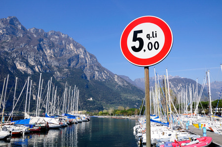 restricting: The sign restricting yacht weight at the marina of Garda lake. Northern Italy. Editorial