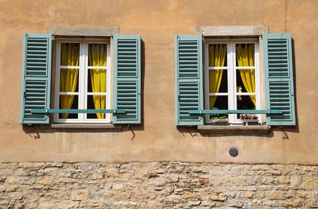 ramshackle: Open windows of old italian house in Verona.