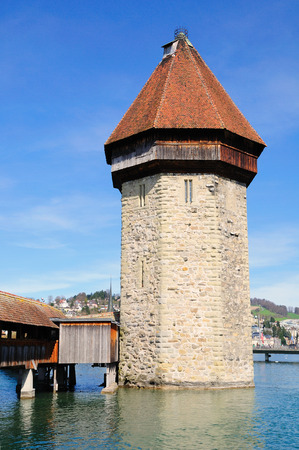 water tower: Lucerne medieval water tower Wasserturm on reuss river. Switzerland.