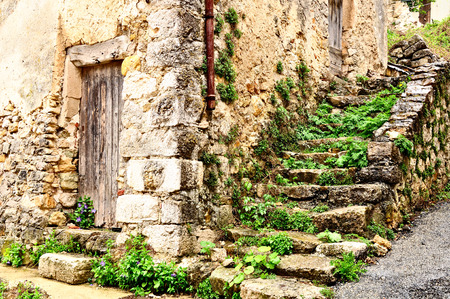 Old derelict house in a medieval french village.