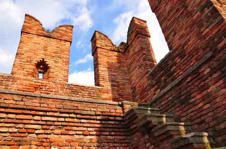 Merlon of castelvecchio bridge made of red bricks. Verona. Italy.