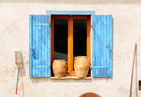 country house style: Country style shuttered window in a rural house. France.