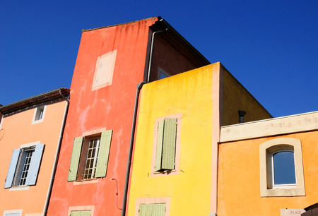 Multicolored residential house in a french village. Imagens
