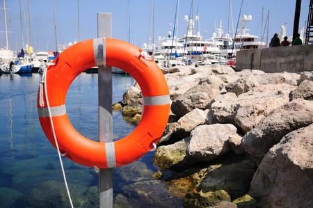 Rescue ring at sea bay in Monaco port.
