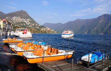 Cruise ships and boats at Lugano lake. Switzerland.