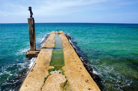 View to mediterranean sea and abandoned concrete pier in old Tel Aviv port. Stock Photo