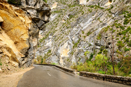 Wet highway in overcast weather in Verdon gorge rocks. France. Stock Photo
