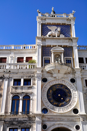 St. Mark clock tower in Venice under cloudless sky. Italy. Stock Photo