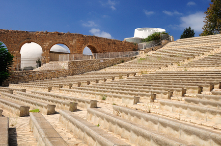 Modern amphitheater and ancient aqueduct in tourist site in northern Israel.