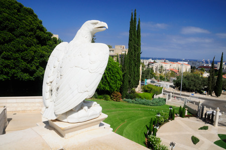 bahai: Statue of white eagle in Bahai gardens of Haifa. Israel. Stock Photo