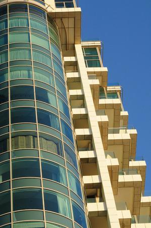 Modern hotel building with big windows in Tel Aviv.
