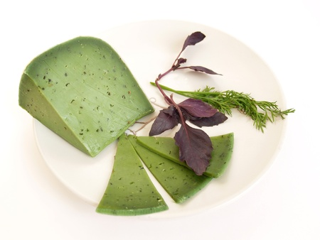 Green cheese and greens on a white background